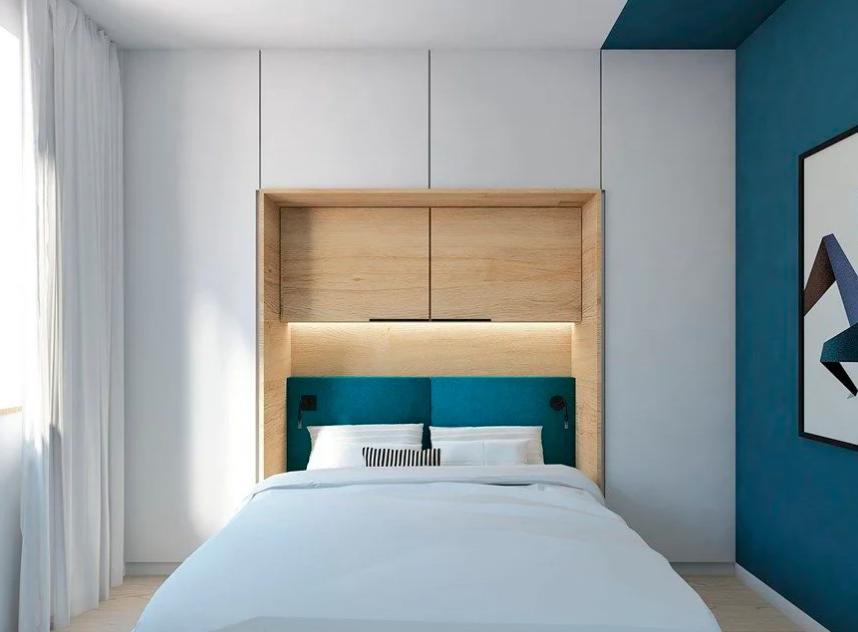шкафы вокруг кровати в спальне